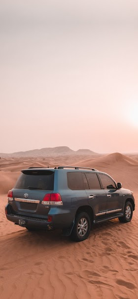 Toyota suv car on brown sand wallpaper
