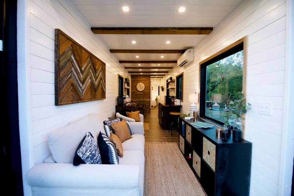 02-Living-Room-and-More-Cargohome-Sustainable-Two-Story-Tiny-Home-Shipping-Containers-www-designstack-co