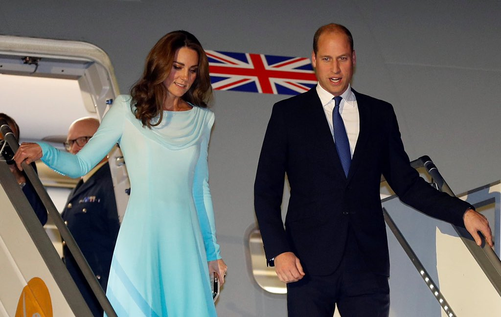 Kate disembarking the plane in a stunning Catherine Walker outfit