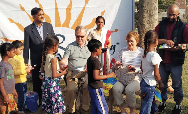 Cancer research scientists from Cambridge University and Cambridge University professors meet Indian children