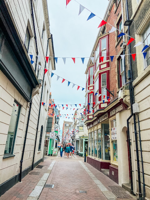 side street in weymouth with bunting