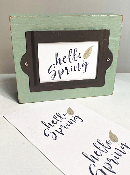 printed hello spring sign in metal label