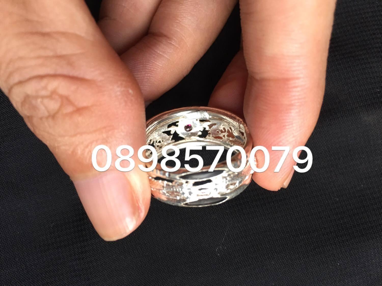Nhẫn rồng song long chầu ngọc chạm thủng bằng bạc + 2 lông voi