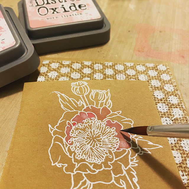 Watercoloring a flower with pink Distress Oxide inks