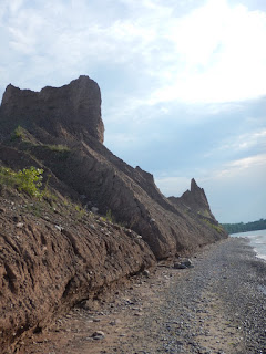 Chimney Bluffs State Park is a 597-acre state park in the town of Huron in Wayne County, New York. The park is situated on the southern shore of Lake Ontario, east of Sodus Bay. From the park's hiking trails, visitors can view the large clay formations at the water's edge for which the park is named. (Source: https://en.wikipedia.org/wiki/Chimney_Bluffs_State_Park)
