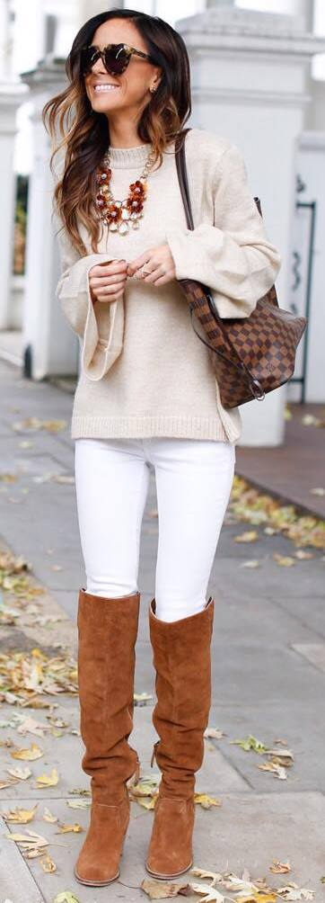 fashionable outfit / nude sweater + bag + white skinnies + brown high boots