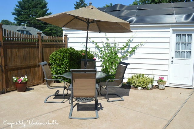 Garden Patio with table and chairs and red umbrella