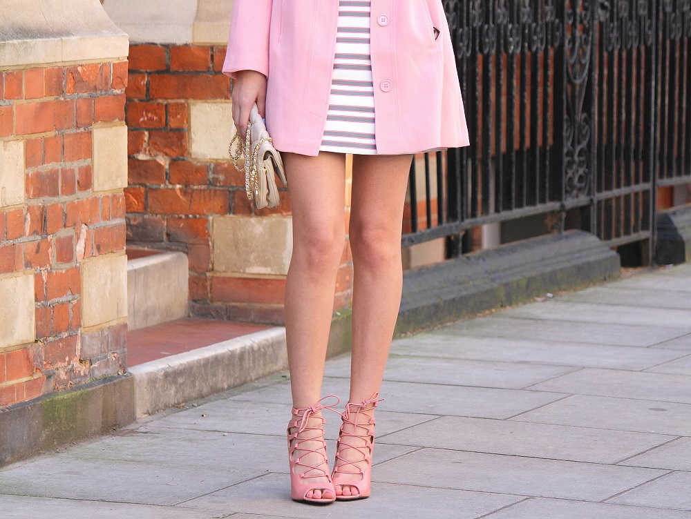 peexo fashion blogger wearing pink striped shift dress and pink coat and lace up heels for spring wedding season