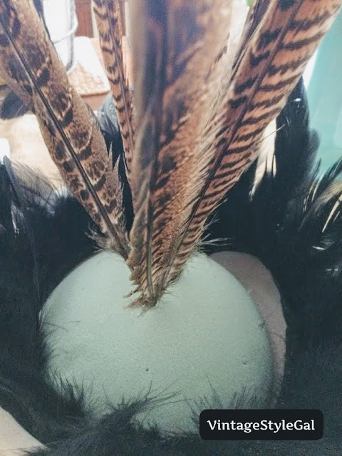 Continuing to add feathers to ball