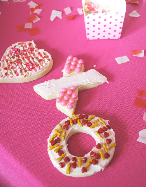 Have fun with your friends this Galentine's Day by hosting a cookie decorating party.