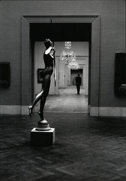 Man walking away from statue of huntress