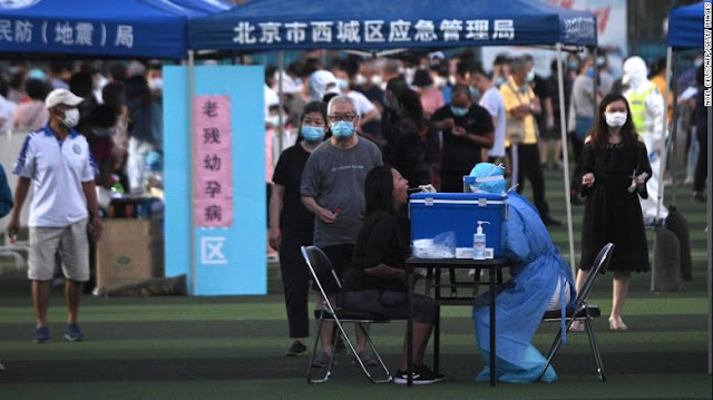 China's new coronavirus outbreak sees Beijing adopt 'wartime' measures as capital races to contain spread
