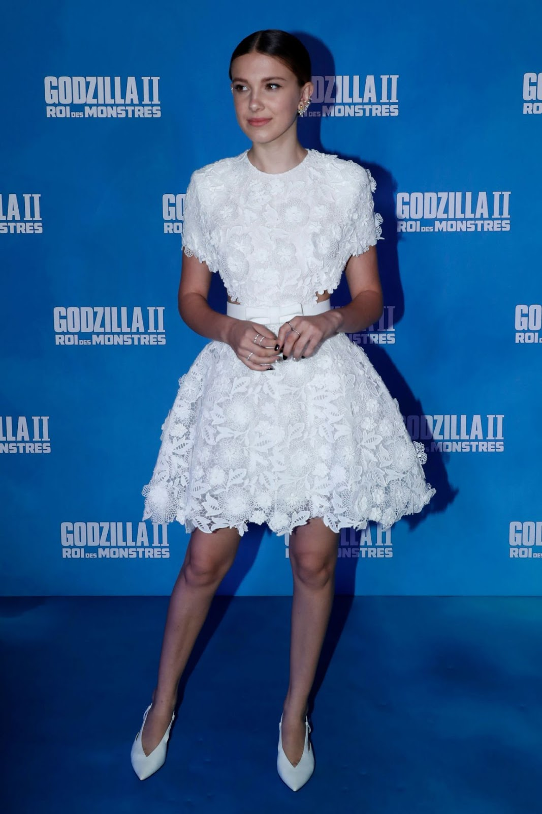 Millie Bobby Brown, 15, displays her chic sense of style in a floral embellished skater dress at the Godzilla premiere in Paris