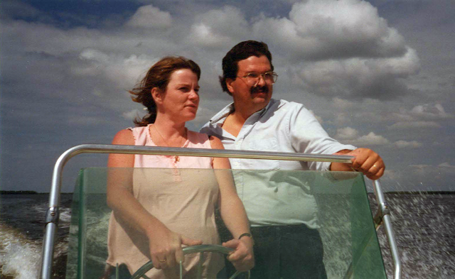 Husband and wife boating in Florida.