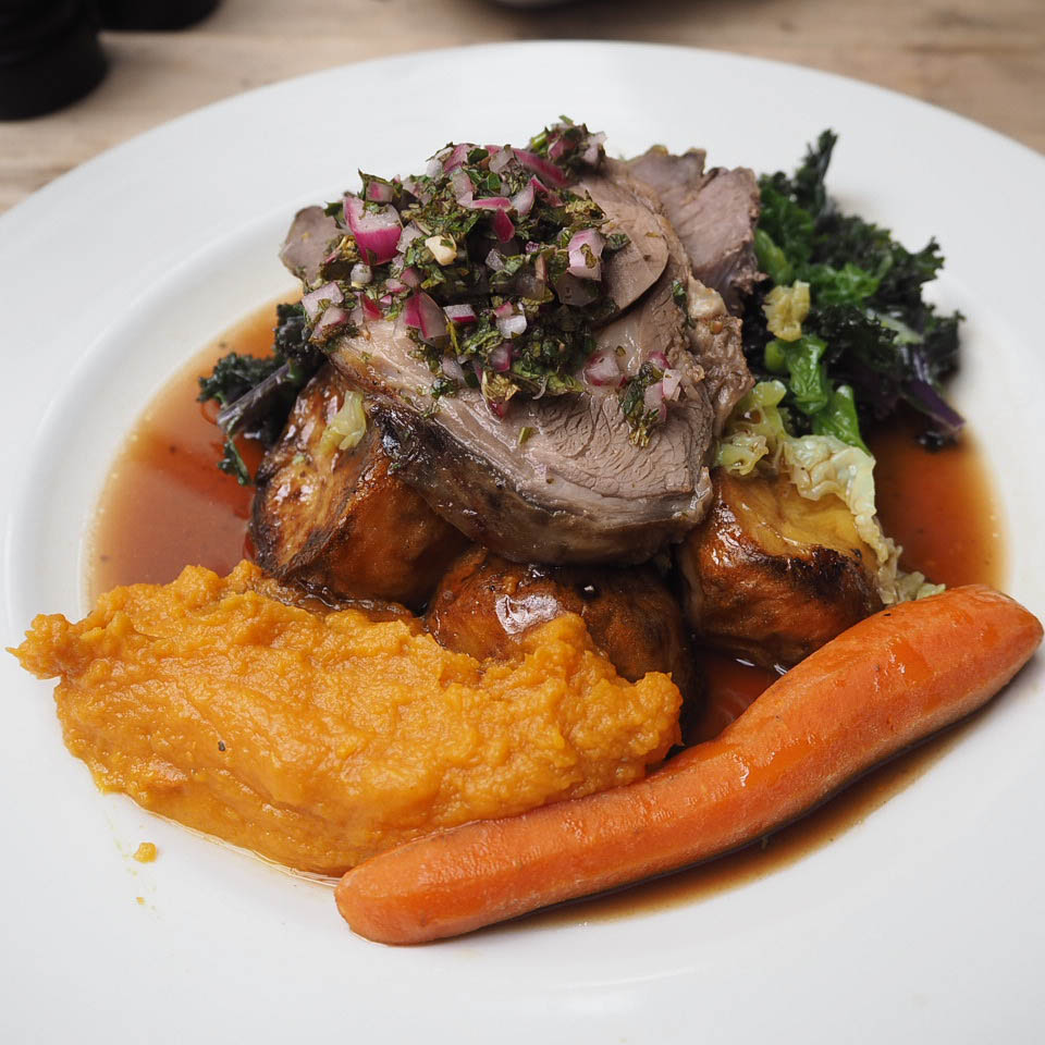 Roast lamb with roast potatoes, sweet potato puree and vegetables