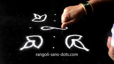 Simple-diya-rangoli-with-dots-1112ab.jpg