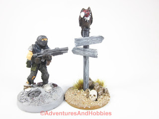Vulture sittng on sign post with 25mm human miniature for scale comparison UniversalTerrain.com