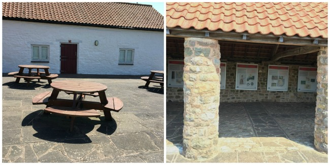 picnic tables and explanation boards