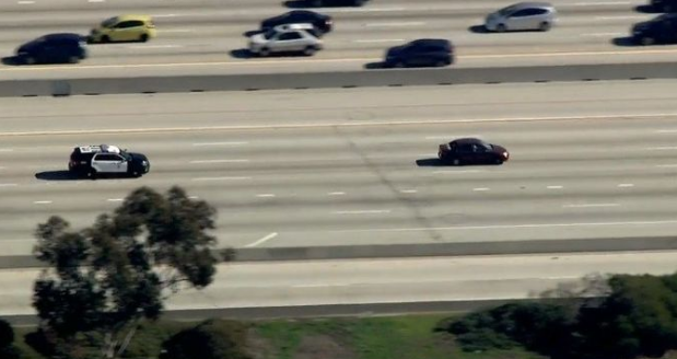 Car leading police on wild chase through Los Angeles strikes pedestrian and keeps driving