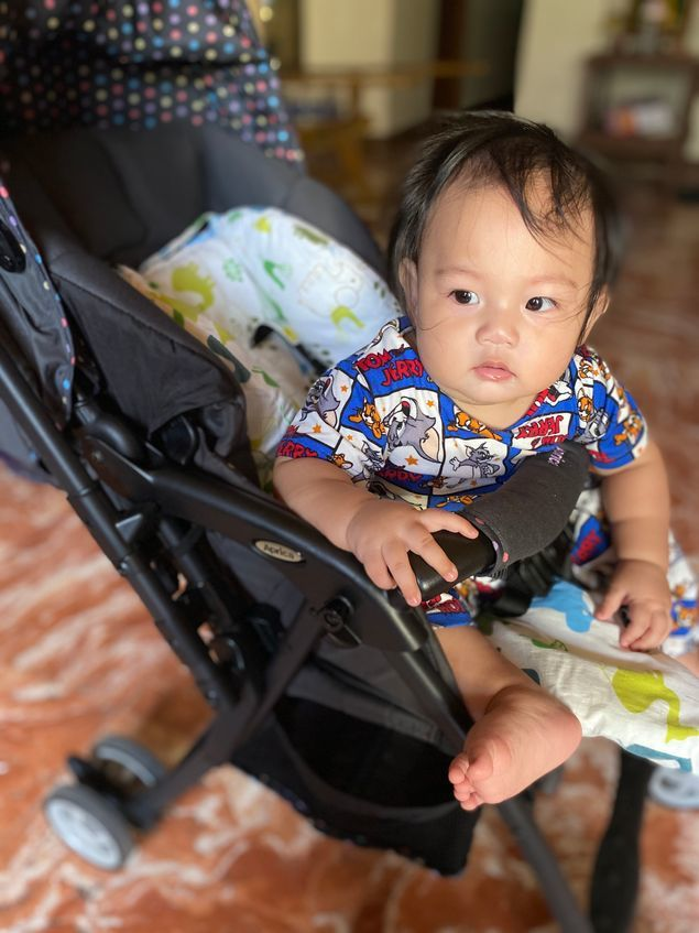 Our little boy comfortably sitting in his Aprica Baby Stroller
