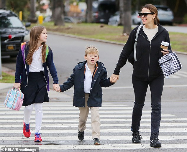 Jennifer Garner with her kids during drizzly LA day
