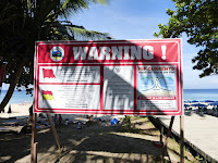 Cartel peligro mareas,Karon Beach, Phuket, Tailandia, La vuelta al mundo de Asun y Ricardo, vuelta al mundo, round the world, mundoporlibre.com