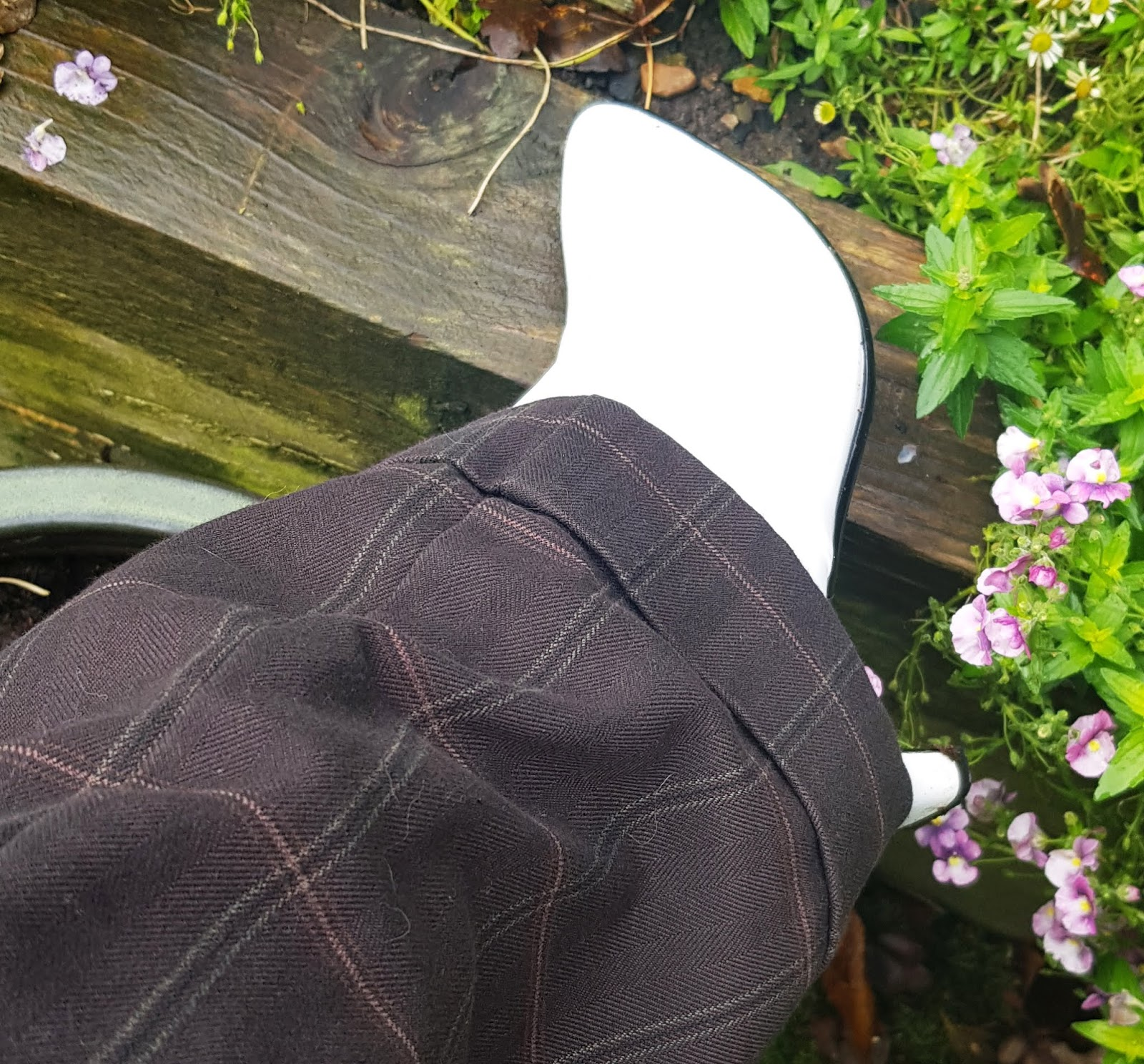 Close-up of check detail on brown Oxford Bag trousers dating from the 1990s, worn by over-50s style blogger Is This Mutton