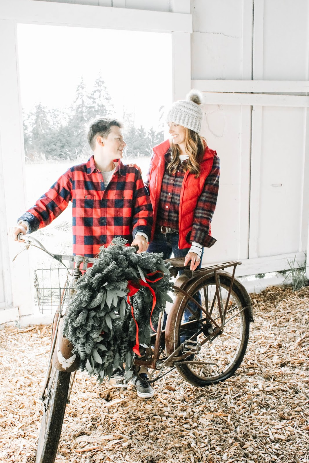 mother and son with a vintage bike with a fresh wreath