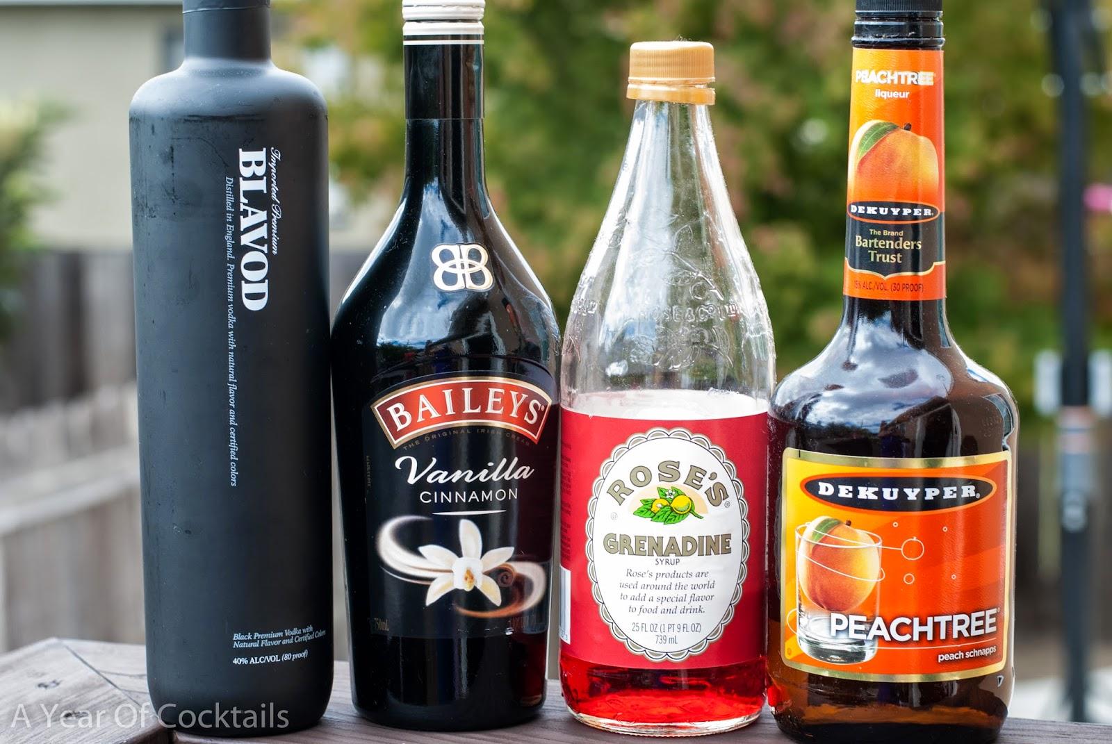 Halloween cocktail, peach schnapps, Baileys vanilla cinnamon, Irish Cream liqueur, black vodka