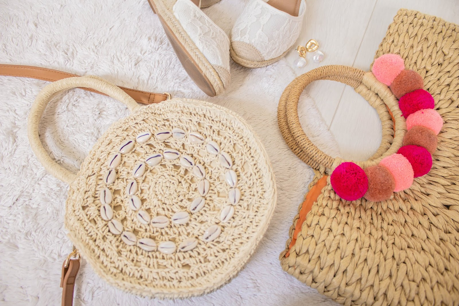 Circular straw bag with sea shell embellishment
