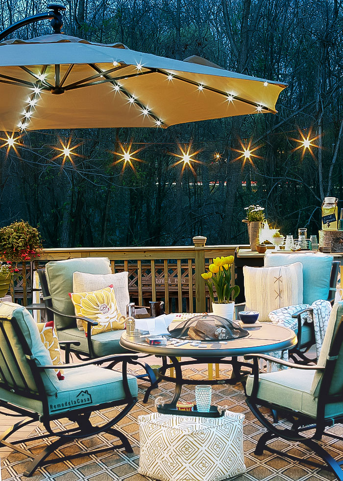 Floating deck with string lights and lighted umbrella