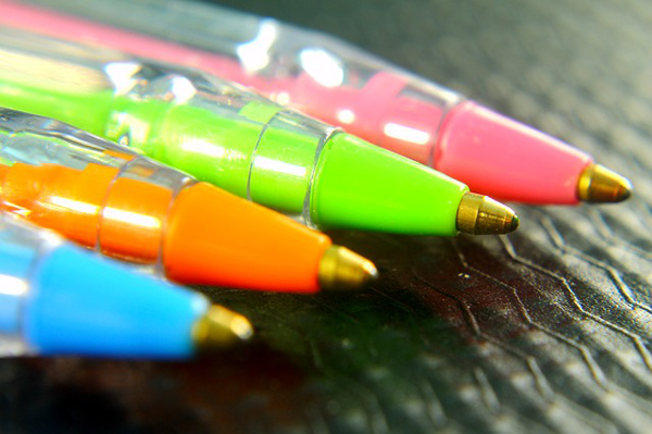 Colorful ballpoint pens green orange blue pink