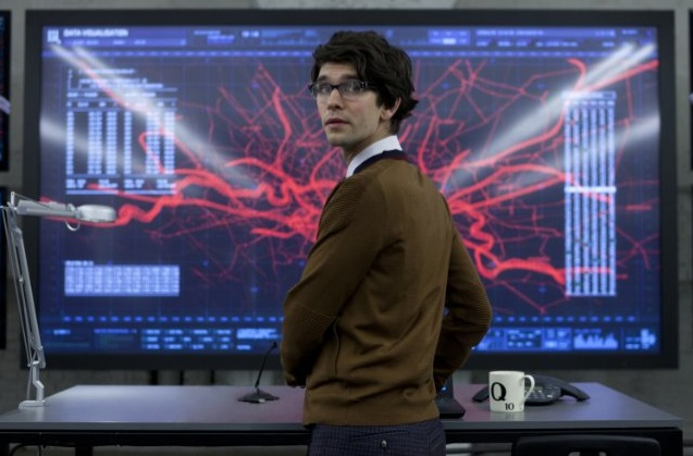 Ben Whishaw as Q at a giant viewscreen