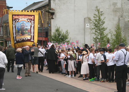 Pupils of St Joseph's RC Primary and the Sacriston Lodge banner on Stanley Front Street (Photo by Durham County Record Office)