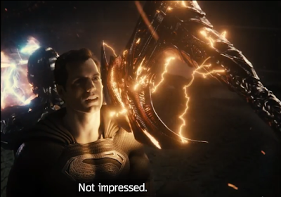 """Superman stopping Steppenwolf's axe with his shoulder and saying """"Not impressed."""""""