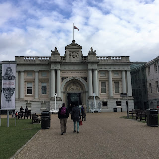 Pepys banner to left on walkway to the National Maritime Museum