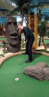 Richard Gottfried making a putt at Star City's Adventure Island Mini Golf course in Birmingham