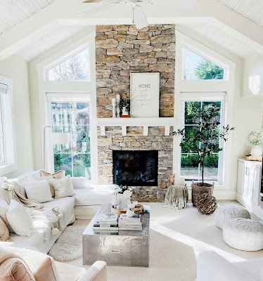 Craftsman style living room with stone fireplace