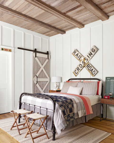 Charming boys room with board and batten walls, barn door, and modern farmhouse style inspiration on Hello Lovely Studio