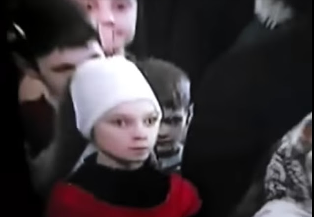 Scary kids next to Putin one is Demonic grey and the other one is Reptilian.