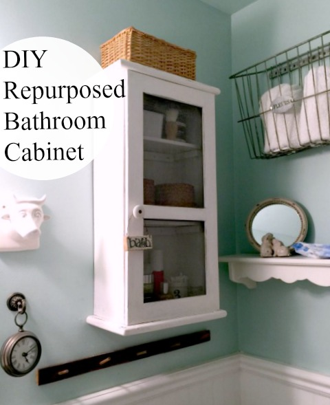 How to Repurpose a Clock into a Farmhouse Bathroom Cabinet www.homeroad.net