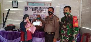Bhabinkamtibmas Polsek Maiwa Bersama Babinsa Bersinergi Kawal Penyaluran BLT Dana Desa Tahap IV Dan V