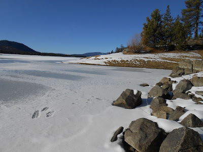 winter, frozen lake, snow, blue sky, rocks