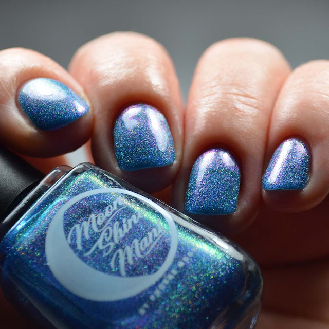blue nail polish with shimmer swatch different angle