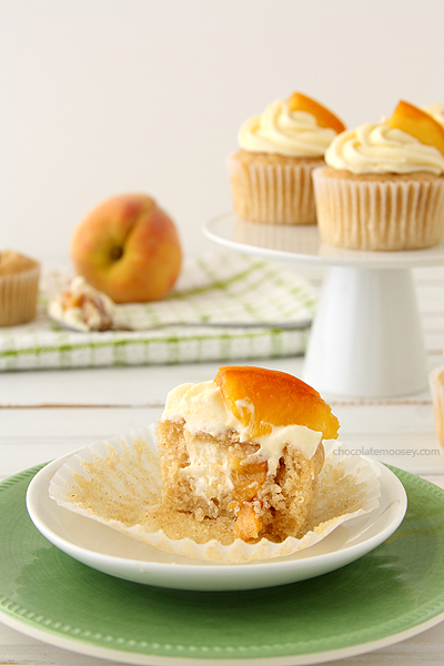 http://www.chocolatemoosey.com/2013/08/19/peaches-and-cream-stuffed-cupcakes/