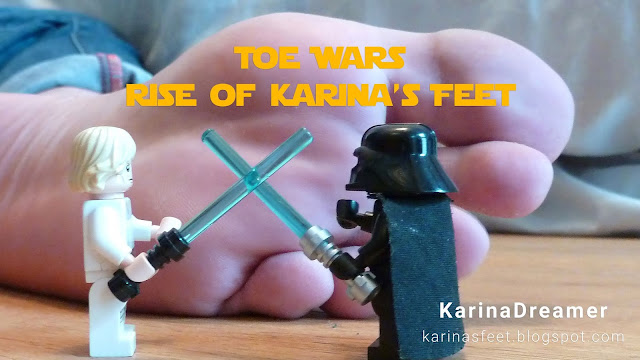 foot fetish picture of foot model karina showing her bare feet with lego star wars figures