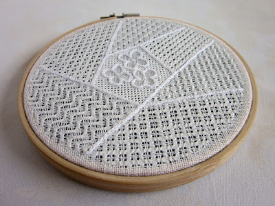 Embroidery of pulled thread sampler in a crazy patch design
