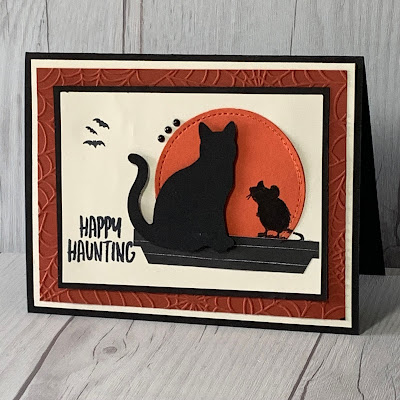 Halloween card with a cat and mouse in silhouette looking at the moon