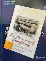 The Meaning of Everything: The Story of the Oxford English Dictionary, by Simon Winchester, superimposed on Intermediate Physics for Medicine and Biology.
