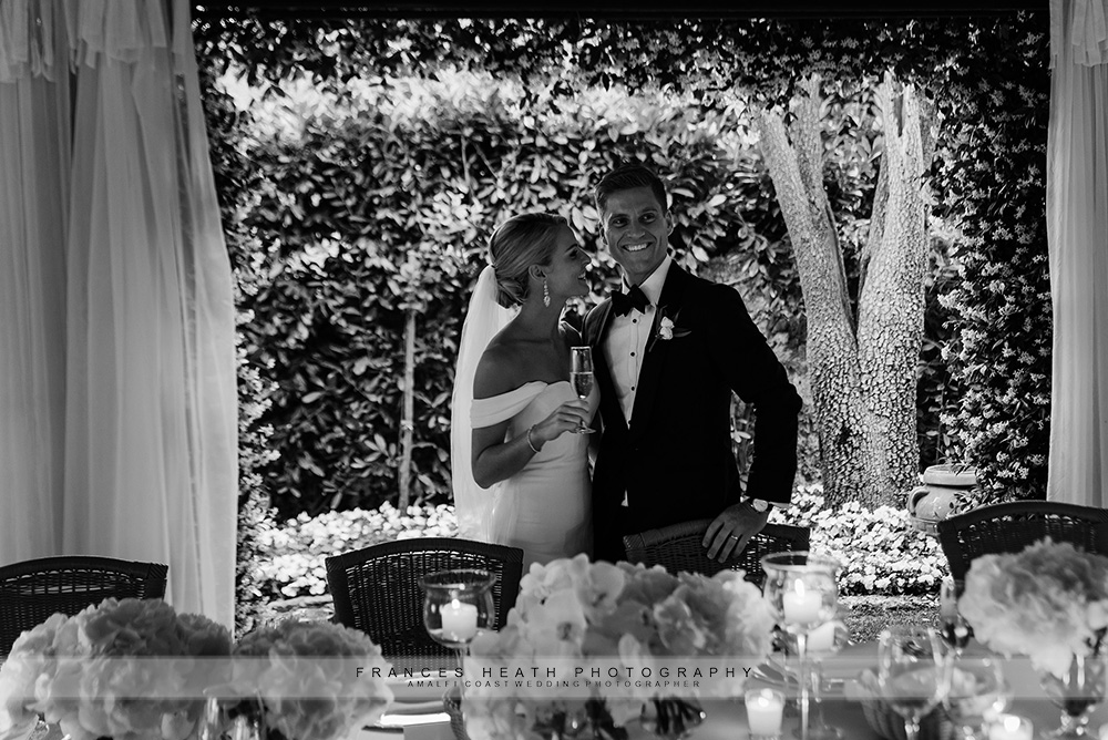 Bride and groom with wedding table at Villa Eva